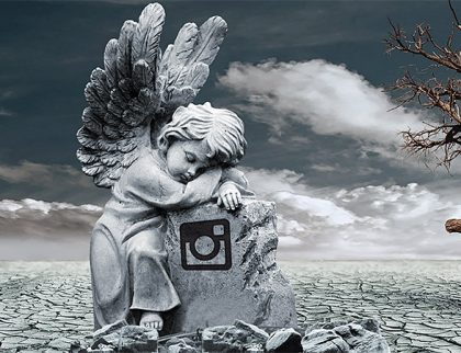 Stone statue of an angel and grave stone on a desert