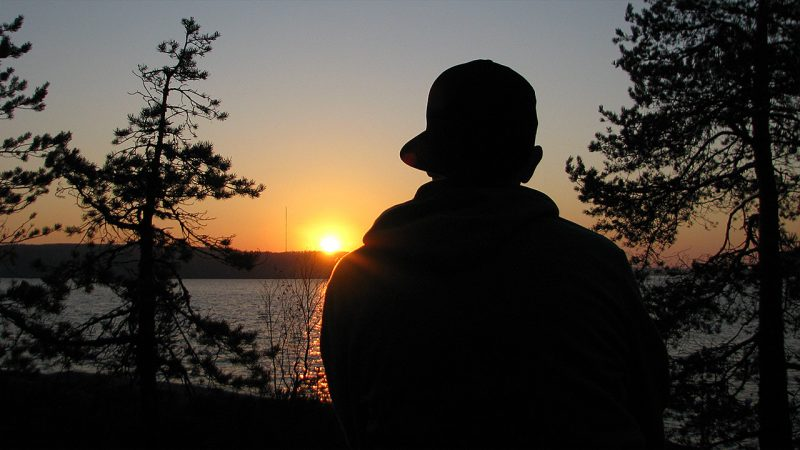 A silhuette of me watching the sunset by the lake.